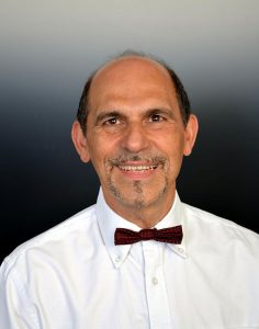 Dr. George John Georgiou,